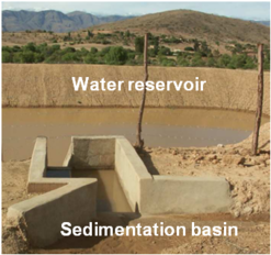 Figure 4: Ex situ rainwater harvesting with small-scale water reservoir (atajado) in the Bolivian Andes with sedimentation basin at the inlet (Photo: Picht, H.J.)